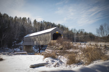 a covered bridge in winter