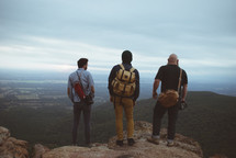 friends standing on top of a mountain
