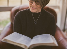 Woman reading the Bible.