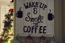 Wake up and smell the coffee sign and Christmas tree