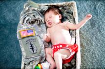 baby sleeping on military fatigues.   Baby Dedication.