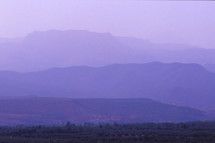 purple sky and purple mountains at sunset