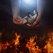God cradling a woman above the flames of Hell