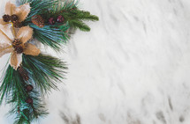Christmas greenery fir branches with berries, pine cones, and burlap leaves