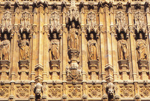 saints and royalty carved into stone on a building