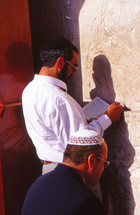 Jewish man praying on the wailing wall