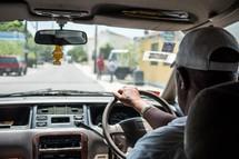a man behind the wheel