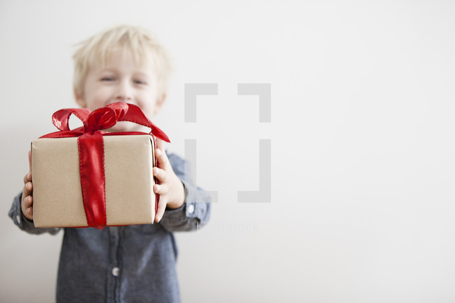 A child holding a Christmas gift