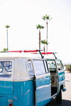 blue and white Volkswagen van