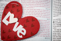 heart with the word love on a Bible