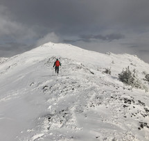 man hiking on a snowy mountain