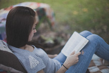 A young woman sitting and reading the Bible