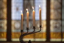 candle sticks on a candelabra