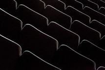 Rows of auditorium chairs.