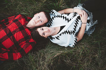a couple lying in the grass