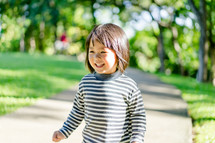 laughing child in a park