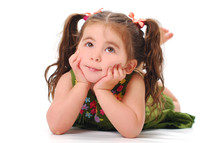 toddler girl in pigtails with her hands and her cheeks
