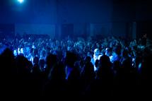 audience under blue light
