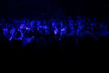 attentive audience under blue light