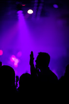 hands raised during a worship service