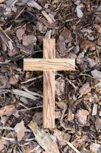 wooden cross on mulch