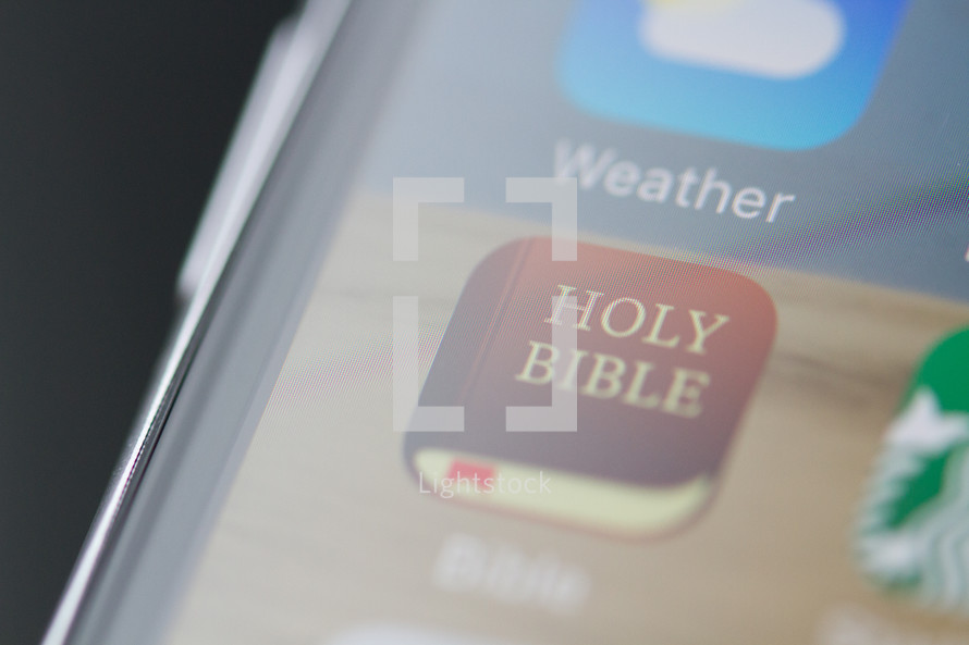 Holy Bible app on a cellphone screen