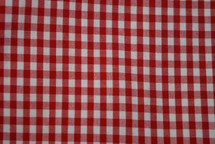 red and white gingham background, picnic blanket