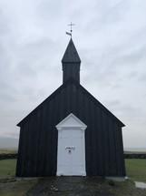 rural black chapel in Iceland