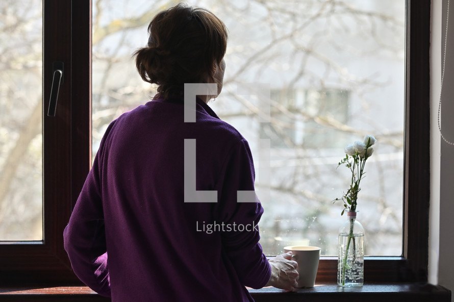 A Self-isolated Woman or Quarantine Looking Out Window Home