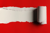 White beneath torn red paper.