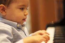toddler boy playing the piano
