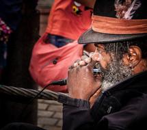 man playing a harmonica