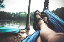 feet in sandals in a hammock