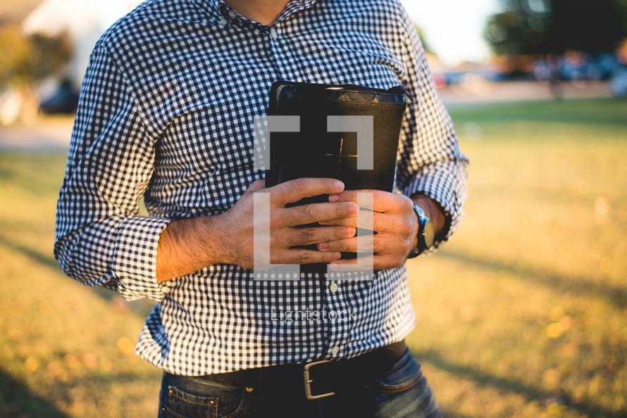 a man holding a Bible