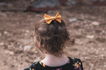 child with a hair bow