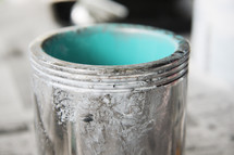 bucket of teal paint