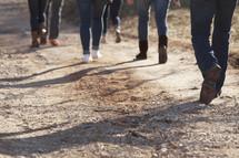 Walking down a dirt road.