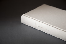 white Bible on a gray background