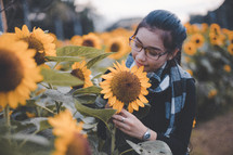a young woman in a field of sunflowers