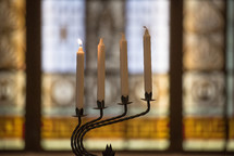 candle sticks on a candelabra