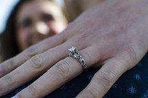just engaged - woman's hand with and engagement ring