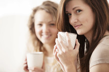 Friends talking over coffee.