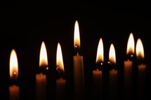 flames from candles in darkness