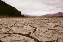 Cracked earth near the mountains.