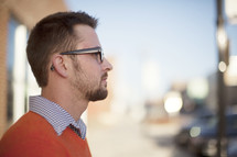 side profile of a man in reading glasses