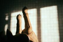dogs feet resting on tile