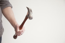 Holding a hammer.