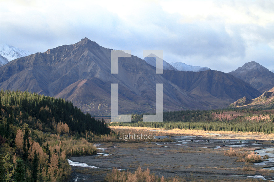 dry river bed and mountains