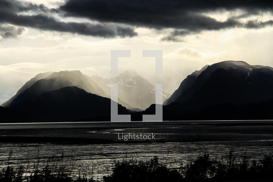 morning sunlight on mountain peaks and lake