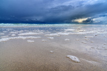 sea foam on a shore